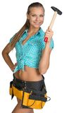 Smiling pretty girl in shorts, shirt and tool belt Royalty Free Stock Photo