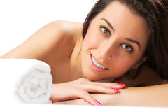 Smiling pretty girl in the spa salon. isolated Royalty Free Stock Photo