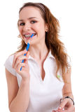 Smiling pretty girl wearing braces and holding a b Royalty Free Stock Photo