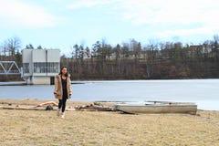 Girl walking from frozen lake royalty free stock photo