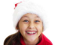 Smiling pretty little girl in a cap of Santa Claus Stock Photography