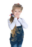 Smiling pretty little girl stands Royalty Free Stock Photo