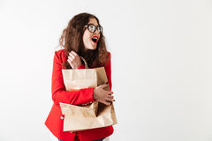 Smiling pretty sale woman holding paper shopping bags Royalty Free Stock Photography