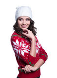 Smiling pretty sexy young woman wearing colorful knitted sweater with christmas ornament and hat. Isolated on white background. Stock Photo