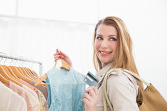 Smiling pretty shopping blonde looking away Stock Image