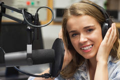Smiling pretty singer recording a song Royalty Free Stock Photos