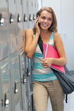 Smiling pretty student phoning Royalty Free Stock Photo