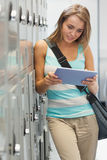 Smiling pretty student using tablet Stock Image