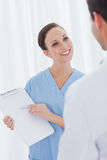 Smiling pretty surgeon talking with doctor Stock Photo