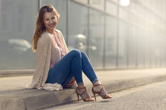 Smiling pretty trendy young woman Stock Images