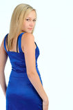 Smiling pretty woman in a blue dress Royalty Free Stock Photos