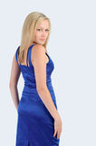 Smiling pretty woman in a blue dress Stock Photography