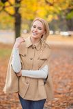 Smiling Pretty Woman in Brown Fashion Outfit Stock Photos