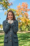 Smiling Pretty Woman Chilling in Gray Coat Royalty Free Stock Photo