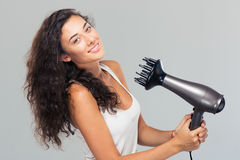 Smiling pretty woman dries her hair Stock Photo