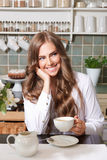 Smiling pretty woman drinking coffee Royalty Free Stock Image