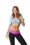 Smiling pretty woman exercising with dumbbells Royalty Free Stock Photos