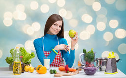 Smiling pretty woman with green apple Stock Image