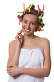 Smiling pretty woman with hair curlers. Royalty Free Stock Images