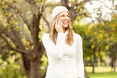 Smiling pretty woman having a phone call Stock Images