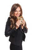 Smiling pretty woman holding a present Royalty Free Stock Photos