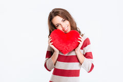 Smiling pretty woman holding red heart Royalty Free Stock Image