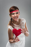 Smiling Pretty Woman Holding Red Heart Royalty Free Stock Images