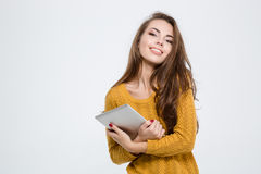 Smiling pretty woman holding tablet computer Stock Photography
