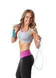 Smiling pretty woman with a  jump rope Royalty Free Stock Photo