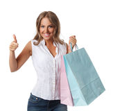 Smiling pretty woman with paper bags Royalty Free Stock Photography