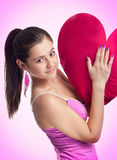 Smiling pretty woman in pink dress Royalty Free Stock Image