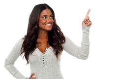 Smiling pretty woman pointing away Stock Images