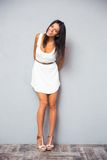 Smiling pretty woman standing in trendy white dress stock photos