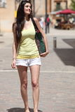 Smiling Pretty Woman Walking at the City Street Royalty Free Stock Photography