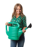 Smiling pretty woman with a watering can Stock Photography