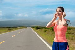 Smiling pretty woman wearing sport clothing Stock Photos