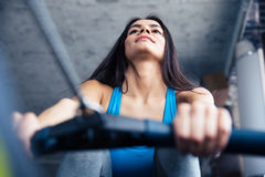 Smiling pretty woman working out at gym Stock Photography