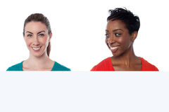 Smiling pretty women over white Stock Photos