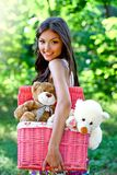 Smiling pretty young caucasian woman in the park Royalty Free Stock Photo