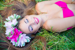 Smiling pretty young lady with long hair in wreath Royalty Free Stock Images