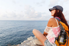 Smiling pretty young tourist admiring the picturesque sea view royalty free stock image