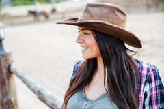 Smiling pretty young woman cowgirl in hat Royalty Free Stock Photography