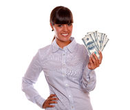 Smiling pretty young woman holding dollars Stock Photos