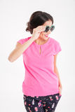 Smiling pretty young woman in pink top wearing round sunglasses Stock Photo