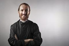 Smiling priest Stock Photos