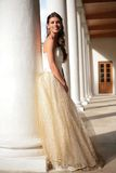 Smiling princess in white-golden gown in gallery Royalty Free Stock Images