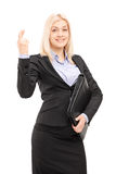 Smiling profession al woman with fingers crossed Royalty Free Stock Image