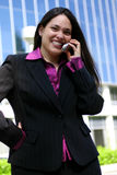 Smiling Professional. Woman out doors talking on phone Stock Photo
