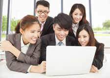 Smiling professional asian business team working in office Stock Image