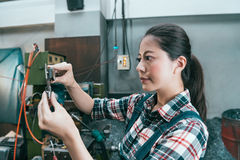 Smiling professional factory female manager. Working in quality control department and using caliper scale manufacture tool inspecting components product stock image